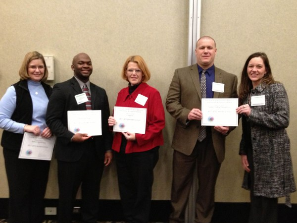 Among the WCS personnel representing their schools at the Department of Public Instruction awards ceremony for schools using the PBIS model were (from left) Joan Ward, teacher of exceptional children and PBIS coach for Watauga High School; Preston Clarke, assistant principal at WHS; Melissa Costin, principal of Parkway School; Patrick Sukow, principal of Blowing Rock school; and Karla Lerner, PBIS coordinator for WCS. Photo submitted