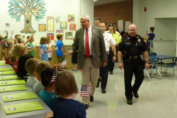 Sheriff Len Hagaman and local law enforcement personnel enjoy the appreciation of Hardin Park students during the hallway parade