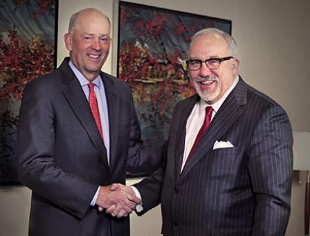 VantageSouth CEO Scott Custer, left, and Yadkin Financial CEO Joe Towell shake hands. Photo by Donn Young/Yadkin Financial