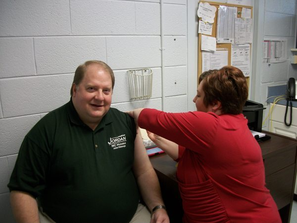 Candy Graham, Clinical Services Manager, Ashe County Health Department administers flu vaccine to Representative Jonathan Jordan.