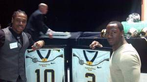 Demetrius McCray (left) and Steven Miller (right) pose with their framed jerseys during Saturday night's Southern Conference championship banquet at the Holmes Center. Photo courtesy of ASU Athletics