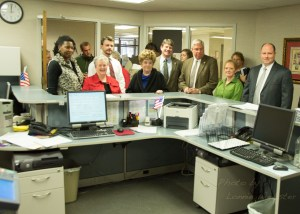 The first batch of candidates pack into the Watauga County Board of Elections office on the first day of filing. From left, Tiffany Christian, Sue Counts, Josh Brannon, Barbara Kinsey, Billy Kennedy, Len Hagaman, Diane Deal and Randy Townsend. Photo by Lonnie Webster
