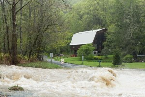 Laurel Creek crashes over a bridge on Laurel Creek Road on Monday. Photo by Lonnie Webster