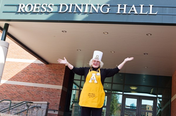 The main dining facility at Appalachian State University has been named for university benefactor Alice G. Roess of Blowing Rock. Roess also received an apron from Appalachian's student body president and a chef's hat from the university's chancellor to mark the occasion. (Photo by Marie Freeman)