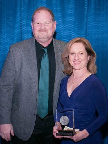 Teresa Lee (right) accepts the 2016 Sara Spencer Child Drama Award from Jeremy Kisling on March 5. Photo credit: Southeastern Theatre Conference.