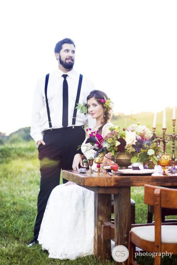 A styled photo shoot for High South Weddings magazine features reclaimed barn wood furniture, a candelabra and other details provided by A Bushel and a Peck. Photo by Calah Stephens Photography.