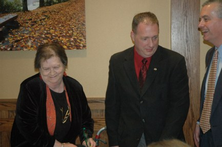 From her seat, Barbara Wright accepted the Jerry Burns Community Ambassador award
