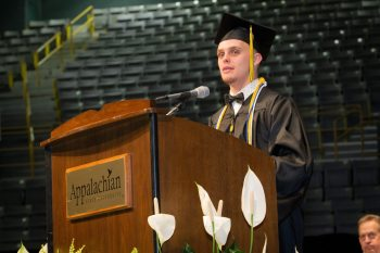 Special education major Nicholas Flippen speaks to graduates of the Reich College of Education.