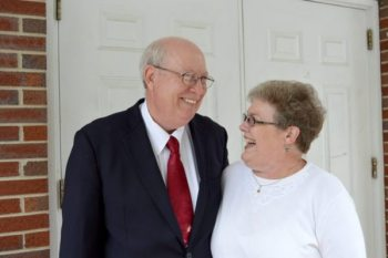 Delmar and Dianne James are pictured in front of Proffit's Grove Baptist Church.