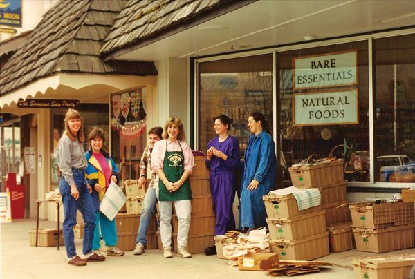 Mary Underwood (center, with apron) is pictured outside of the original Bare Essentials storefront in downtown Boone, which housed the market from 1988-1998.