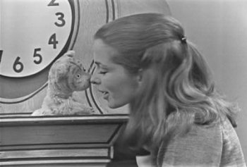 "Characters Daniel Striped Tiger and Lady Aberlin share an ""ugga mugga"" in episode 0036 of Mister Rogers' Neighborhood. Screenshot from neighborhoodarchive.com."