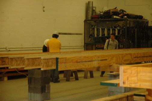 Just one month ago, the team was busy working on the floor structure. Now they are busy adding walls.