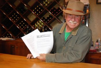 Steve Tatum, owner of Grandfather Vineyard and Winery, holds up some of the AVA paperwork on Wednesday. Photo by Ken Ketchie