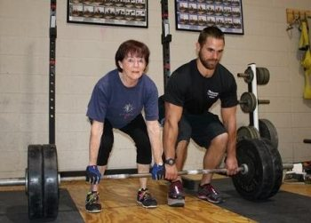 Jill Storelli ties world deadlifting record with personal trainer Michael Darling at her side.
