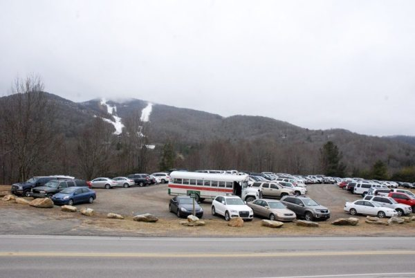 On Jan. 2, Sugar Mountain Resort had an overflow of visitors at a lot off of N.C. 184. Photo by Ken Ketchie