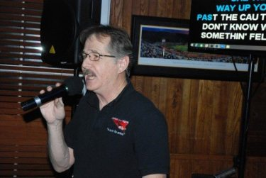 Sound Technique Mobile DJ owner Keith Richardson usually sings the first song to warm up the crowd. Here he is at the Blowing Rock Town Tavern last weekend.