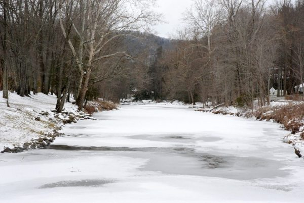 The Watauga River in Valle Crucis is frozen over on Wednesday. Photo by Ken Ketchie