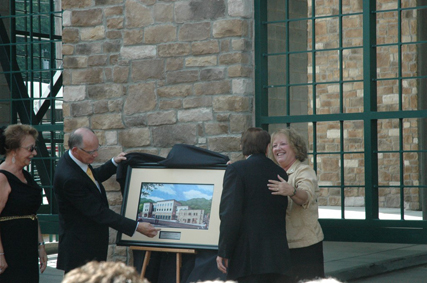 Chancellor Peacock and Dean Treadaway presenting a rendering of the complex to the Beasleys