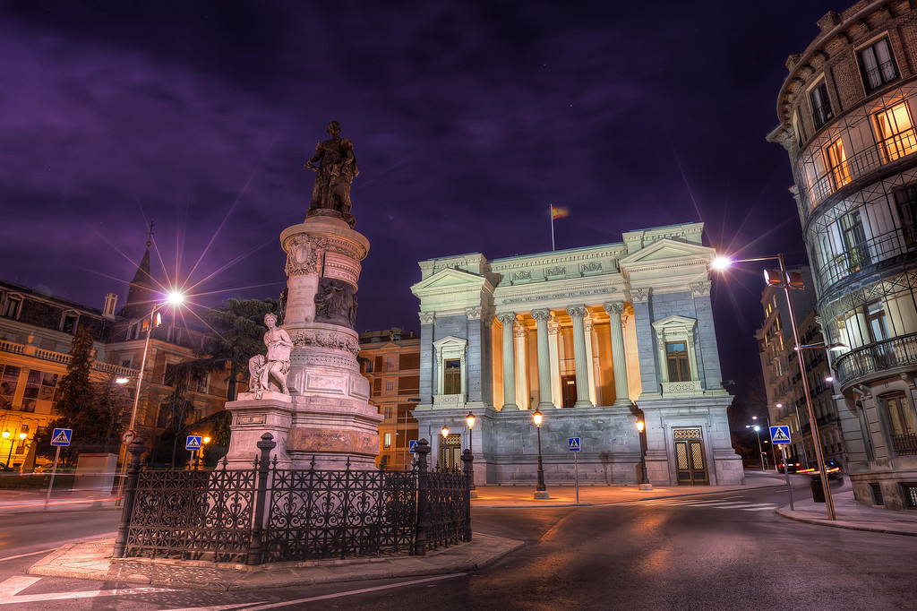 Last night in MadridThis was taken the last night I was in Madrid. My friends decided to visit a gallery, but I preferred a place where I could take photos. This was again a scene like created for a HDR. The whole bottom part is very light, with the building and the base of the statue very bright. On the other side, the sky was dark, and the statue has no lights pointing to it.  But with HDR I got both.Get more info about this photo on my blog http://blog.hdrshooter.net