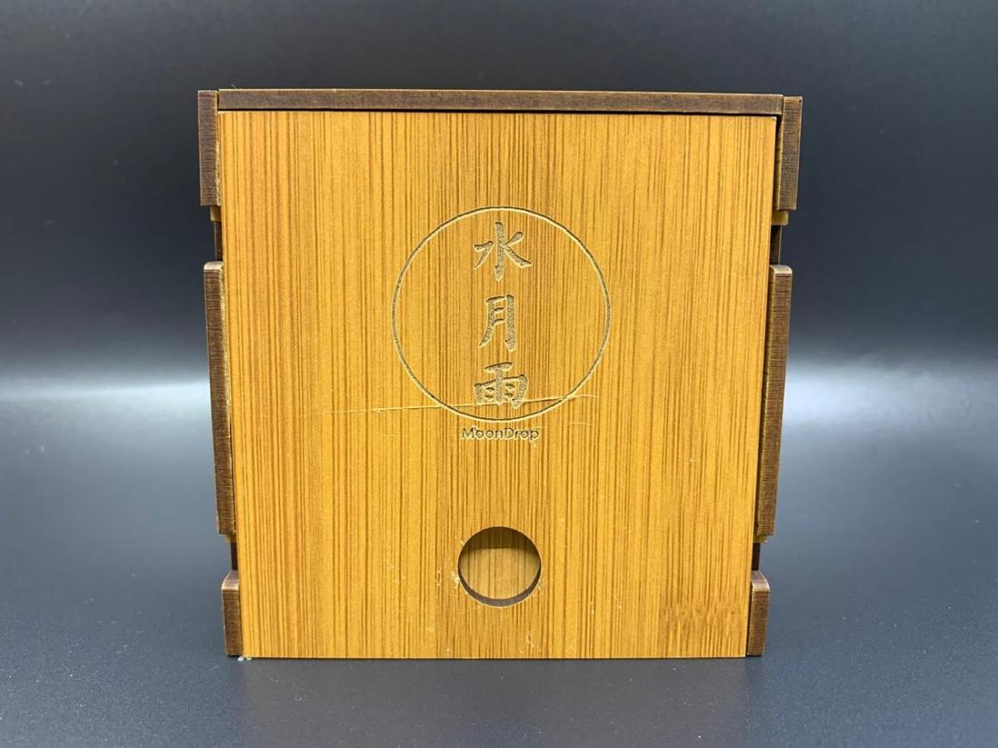 The blessing is enclosed in a wooden box.