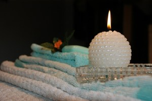 spa candle and towels