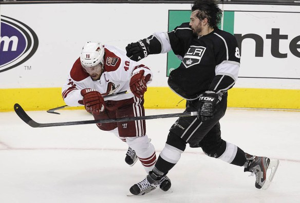 Kings defenseman Drew Doughty throws off Coyotes winger Shane Doan after they tackle each other at center ice late in Game 3 of the NHL Western Conference Finals.photo courtesy of framework.latimes.com-
