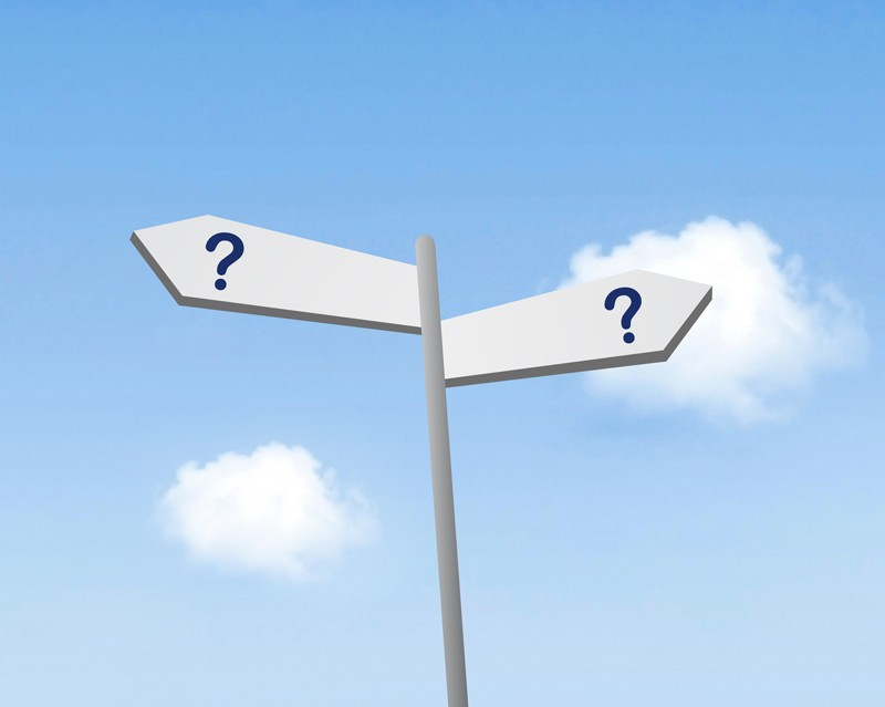 Sign post with question marks on two signs pointing in opposite directions