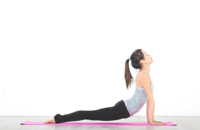 The Best Yoga Stretches To Do After A Long Flight Or Car Ride
