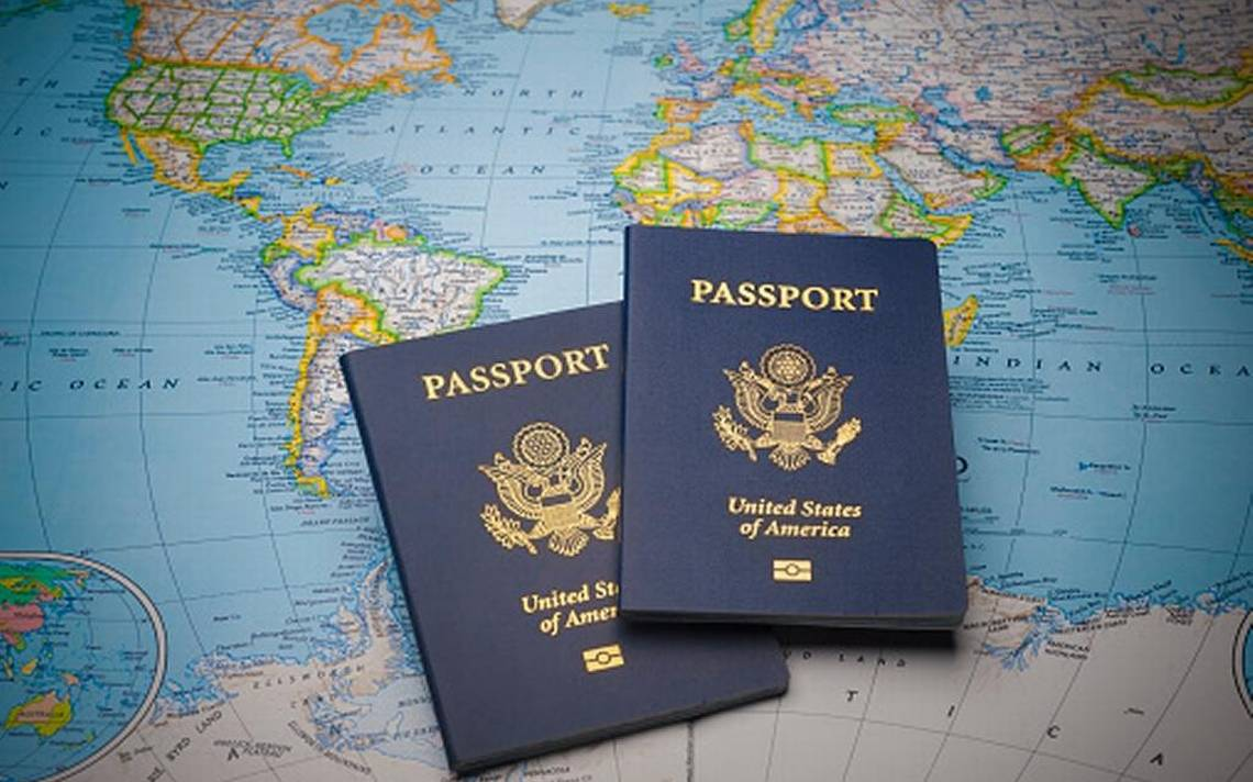 two united states passports in top of a world map image