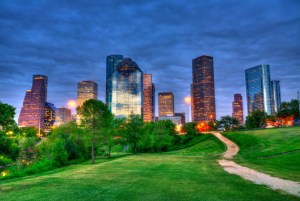 Houston Texas modern skyline at sunset twilight from park