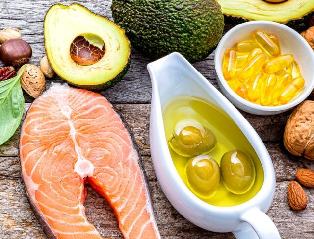 Table with Salmon and avocado Natural Supplements for Beautiful Skin