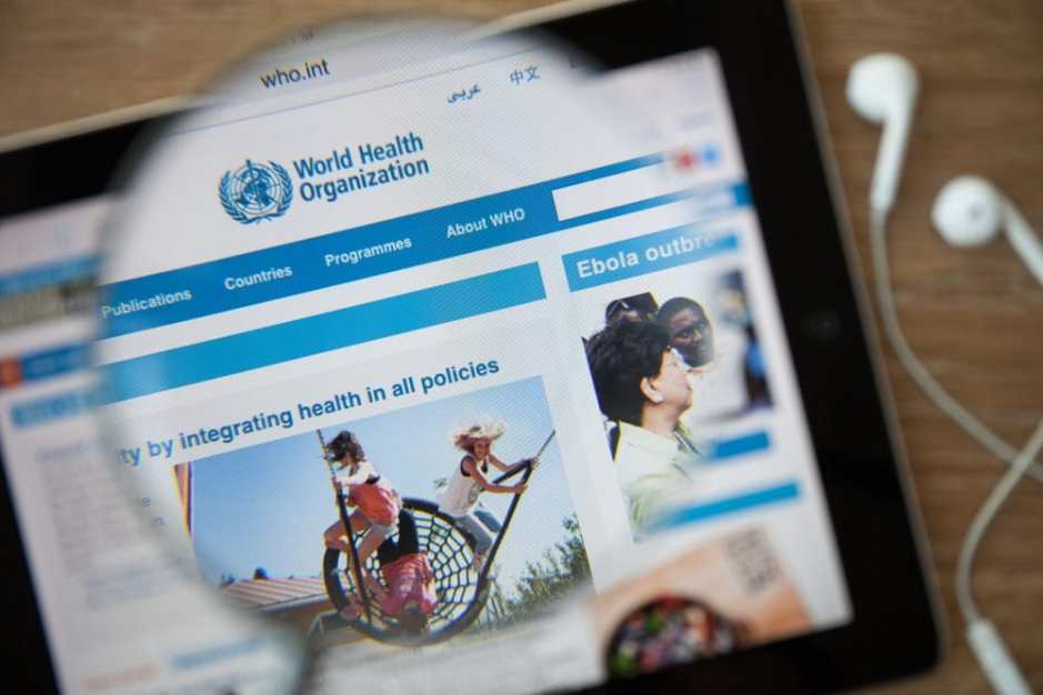 42840567 - chiangmai, thailand - february 26, 2015: world health organization homepage through a magnifying glass. who is a specialized agency of the un that is concerned with international public health. Copyright: aradaphotography / 123RF Stock Photo
