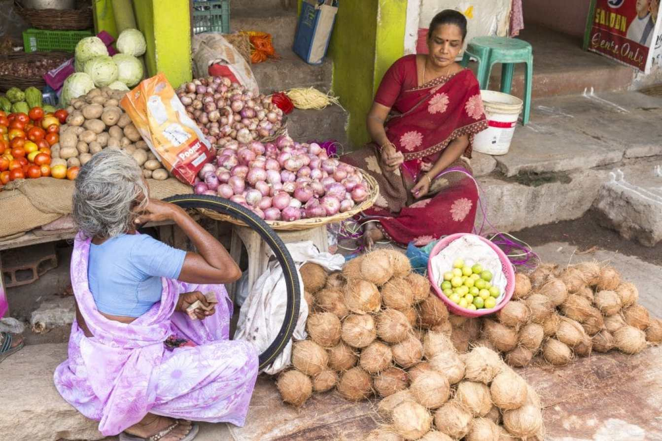 Food produce. Illustrative image. Pondichery, Tamil Nadu, India - May 14, 2014. Vegetables and fruits market place, colored shops, sold by men or women