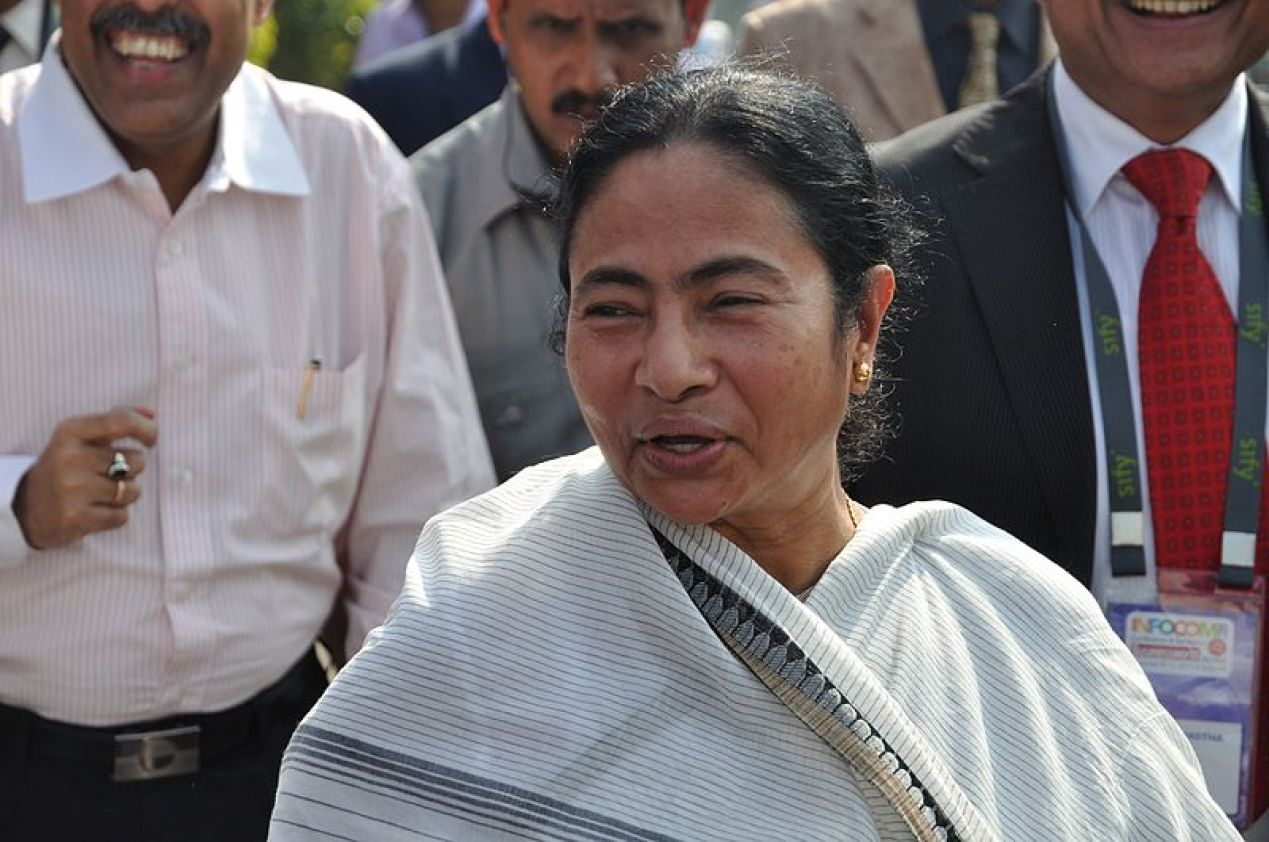 """Mamata Banerjee (Bengali: মমতা বন্দ্যোপাধ্যায়; Hindi: ममता बनर्जी, pronounced [mɔːmoːt̪ʰaː bɛːnaːrjiː]; born 5 January 1955) is the 11th and current chief minister of the Indian state of West Bengal. She is the first woman to hold the office. Banerjee founded All India Trinamool Congress in 1997 and became chairperson, after separating from the Indian National Congress. Currently she is also in charge of nine key departments of the government of West Bengal, including Home, Health and Family Welfare, Land and Land Reforms, Information and Cultural Affairs, Minority Affairs and Madrassah Education, Agriculture, Power and Home (Personnel and Administrative Reforms) departments. She is popularly referred to as """"Didi"""" (meaning elder sister) to all her followers. This photograph has been taken during the inauguration of the 'Infocom 2011' exhibition at Milan mela ground, Kolkata."""
