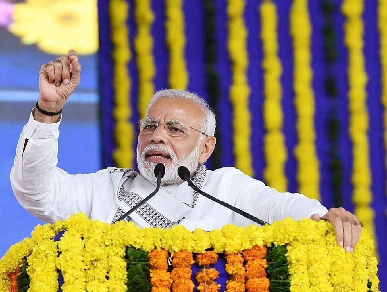 The Prime Minister, Shri Narendra Modi addressing a public meeting, in Junagadh district, Gujarat on August 23, 2018.