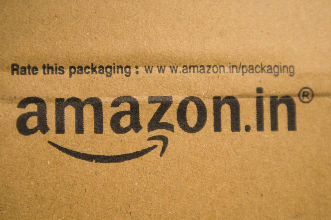 BANGALORE INDIA June 13, 2019 : Amazon in printed on cardboard in India. Image credit: Lakshmiprasad Sindhnur / 123rf