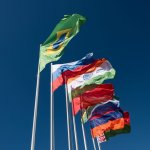 Flags of the BRICS countries in the blue sky. Image credit: mrilkin / 123rf
