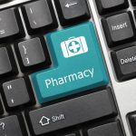 Close-up view on conceptual keyboard - Pharmacy (blue key)