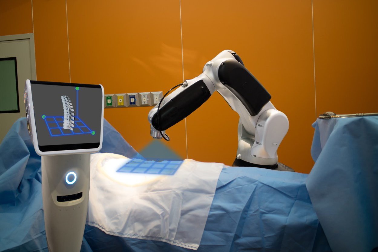 the robot assistant and AI in medical technology use for scan a patient before spinal surgery and send the data of 3d spinal to the monitor on robot it help to pinpoint instrument accuracy for quicker, safer