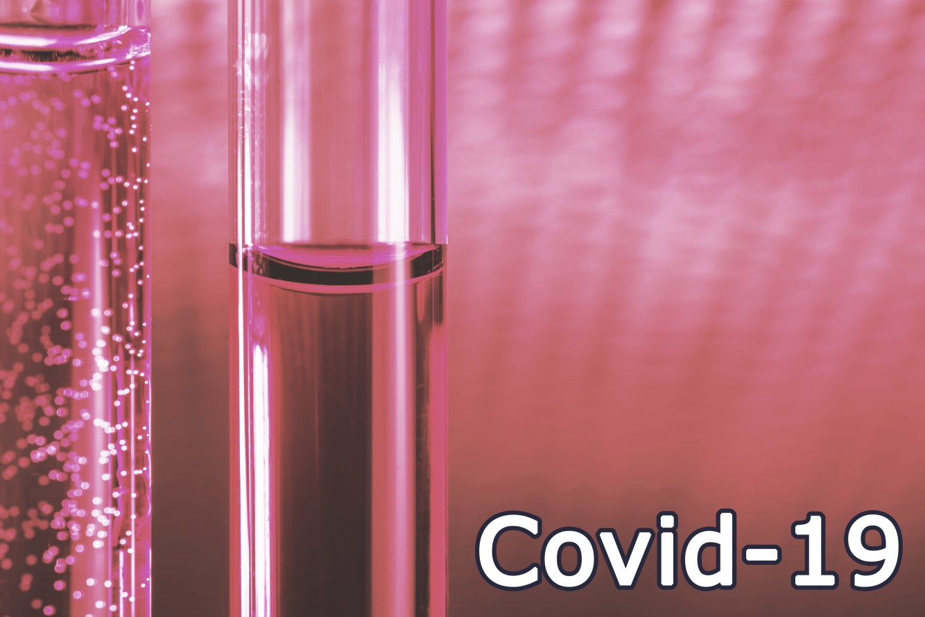 Covid-19. Red liquid vaccine in glass tubes.. Cases of COVID-19 illustration. Image credit: Ivan Uralsky. vaccine hesitancy concept