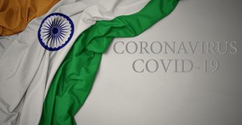 pandemic preparation waving colorful national flag of india on a gray background with text coronavirus covid-19 . concept.. COVID-19 cases in India illustration. Indian COVID-19 cases concept. Cases of COVID-19 crisis in India concept. Image credit: luzitanija / 123rf. Used to illustrate one million deaths due to the pandemic. covid-19 vaccine supplies in india