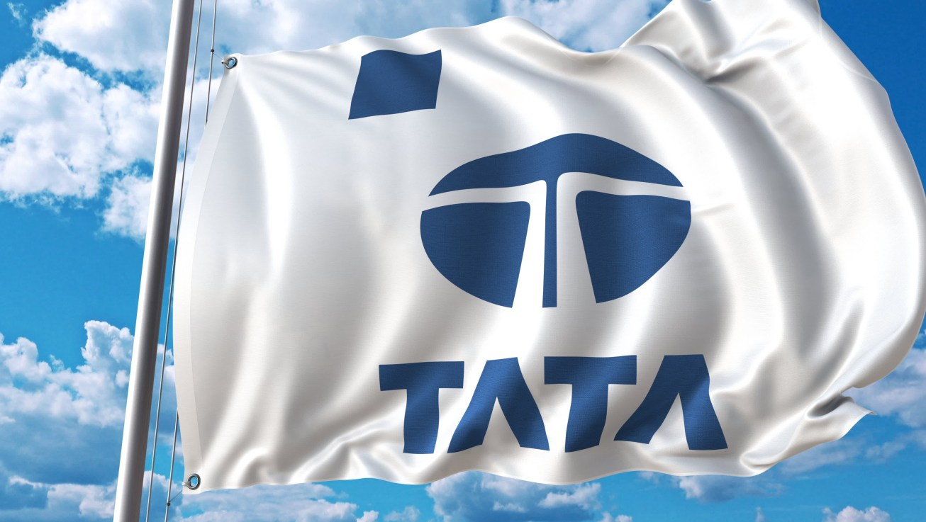 Waving flag with Tata logo against sky and clouds. Editorial 3D