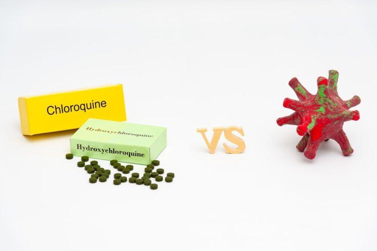 HCQ / Hydroxychloroquine / Chloroquine versus coronavirus (DIY - homemade model made with modeling clay). Isolated on white background. Copy space. Horizontal shot.