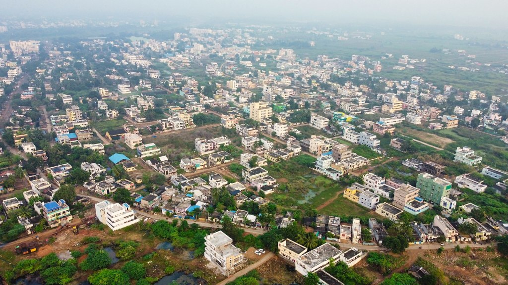 Aerial view of Pushpaleenanagar in Tangellamudi, a census town and locality in Eluru. Eluru has witnessed an outbreak of a mysterious illness in recent days. Image credit: iMahesh, CC BY-SA 4.0 , via Wikimedia Commons