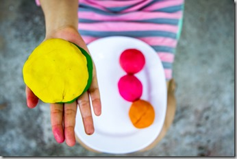 Colorful  play dough om hand