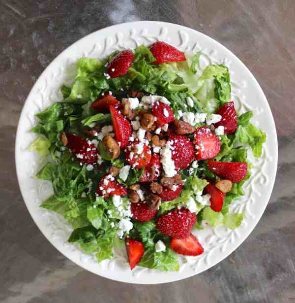 Strawberry salad with poppyseed dressing, pecans, feta, and poppyseed dressing