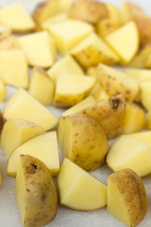 Chopped yellow potatoes for warm roasted potato salad