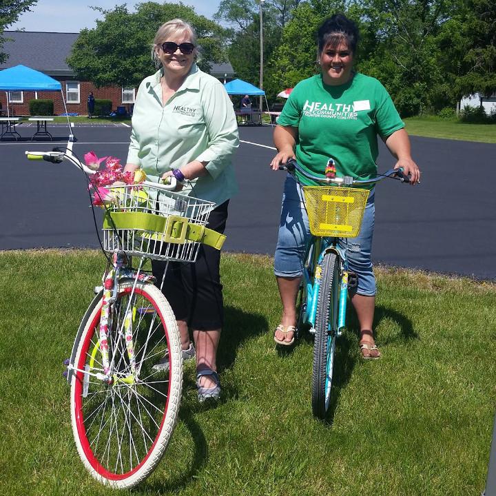 Staff Members on Bikes