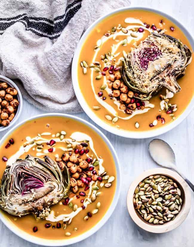 creamy pumpkin soup with crispy chickpeas, pomegranate seeds, pumpkin cashew cream