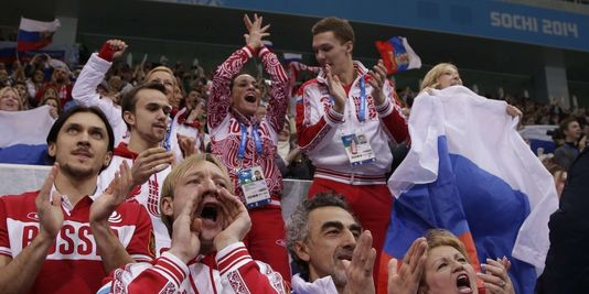 Evgeni Plushenko cheering on team event at Sochi Olympics